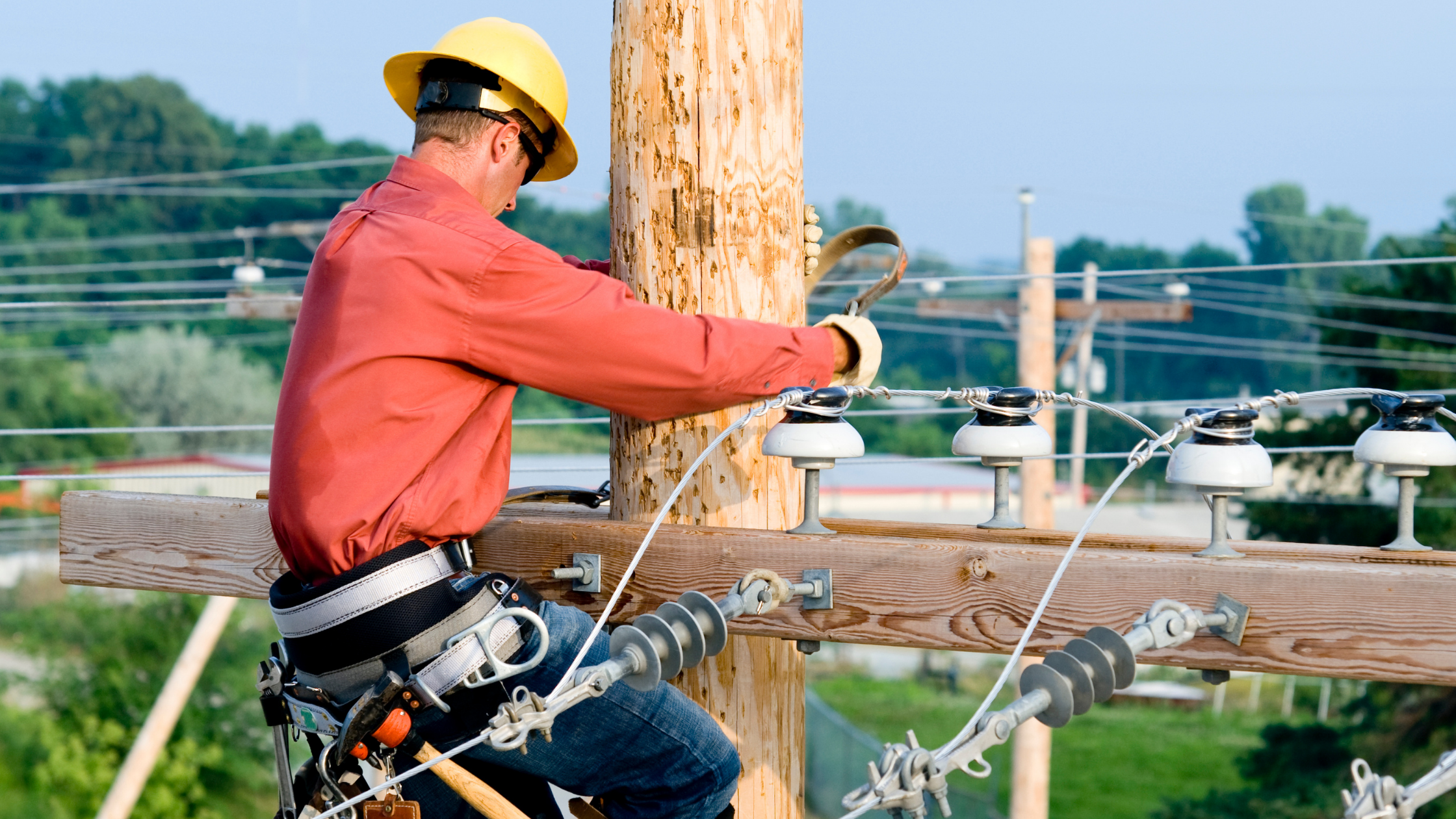 Electrical Worker on Utility Pole